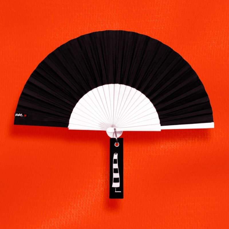 BLOW hand fan in black fabric, white painted wood frame, embroidered tag (black and white windsock graphic).