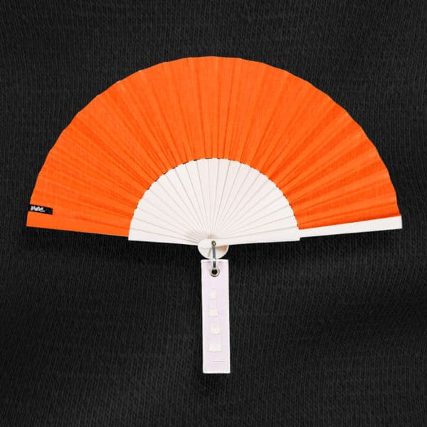 BLOW hand fan in navy blue fabric, white painted wood frame, white embroidered label with windsock design.