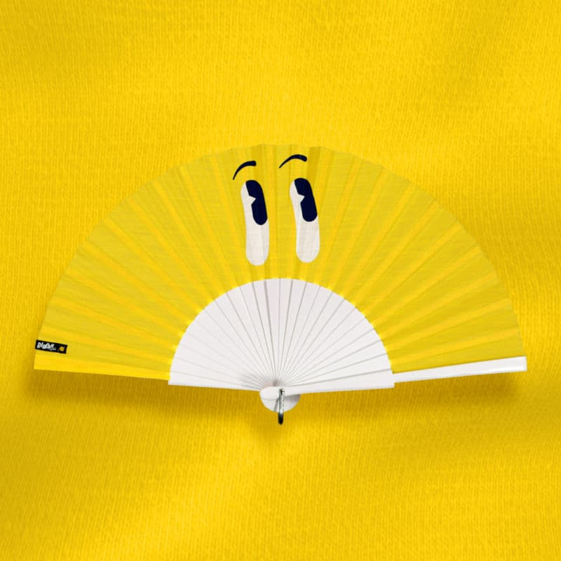 LOOK hand fan on yellow fabric, screen-printed white and blue cartoon eyes, wooden frame painted in white
