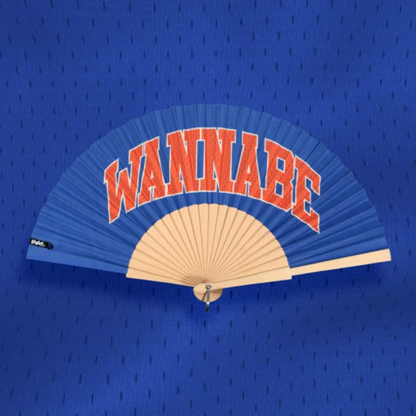 WANNABE hand fan in printed fabric, text, red-orange type on blue background, natural wood frame