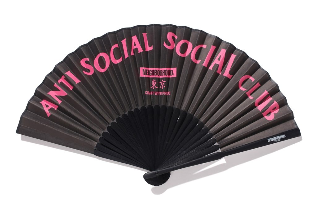 Black and pink Japanese type fan on a white background, Anti Social Social Club and Neighborhood brands logos.
