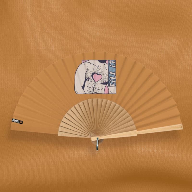 "FILL IT hand fan (""Naughty Boys"" series) in printed fabric, multicolored illustration (drawing of a muscular and hairy man's torso with a heart-shaped cavity) with typographic inscription ""Fill it"", on an orange-brown background, hand-polished natural wood frame"