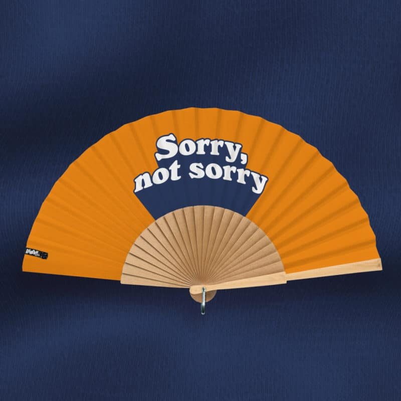 "SORRY, NOT SORRY fan (""Notif"" series) in printed fabric, text pattern, white and navy blue 3D typography on orange background, hand polished natural wood frame"